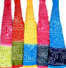 """Bandhani is a type of tie-dye textile decorated by plucking the cloth with the fingernails into many tiny bindings that form a figurative design. The term bandhani is derived from the Sanskrit word banda (""""to tie"""").[1] [2] Today most Bandhini making centers are situated in Gujarat, Rajasthan, Sindh, Punjab region[3] and in Tamil Nadu where it's known as Sungudi."""