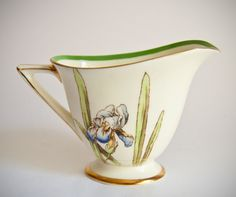 Doulton deco: Iris creamer / milk jug, V1346, c1940 (14). Blue irises and green leaves with green banded design and gold gilt highlights and trim. Sometimes used as gravy boat.