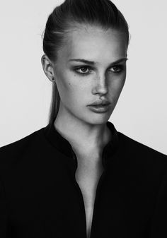 Olivia Frederikke: ponytail, amazing cheekbones, freckles scattered across nose and onto upper cheekbones. Freckles add a degree of wholesomeness to her overall look. Charming.