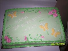 flowers and butterflies - A 1/2 sheet cake, half and half (choc. and vanilla) buttercream icing. This was done for one of my sons friends Mother, her favorite color is green, and they just wanted flowers and butterflies. Once done, I wish I had wrote the happy birthday in yellow, the white actually showed up better in person then in the picture but I still think yellow would have been best.  She really liked her cake though