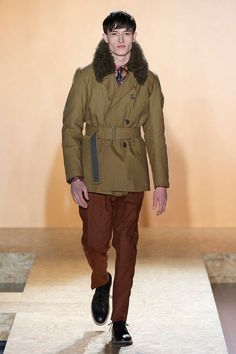 paul smith in the fall 2013. furs around neck looks warm and rich. this coat reminds military look.