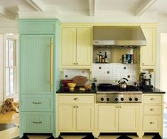 The furniture-like cabinets and fridge in this kitchen are painted a duo of complementary colors for a bright yet vintage feel. For a similar look, try: Banana Pudding (yellow) and Sprite Twist (green), Pittsburgh PaintsPhoto: Eric Roth | thisoldhouse.com