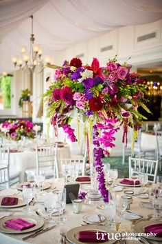 Bold colors. Beautiful wedding centerpiece. This shows short and tall complimentary arrangements.
