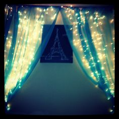 So just a few twist ties some icicle Christmas lights some sheer curtains a curtain rid and a painting of the Eiffel Tower then you have a Paris themes room! :) costs about $50