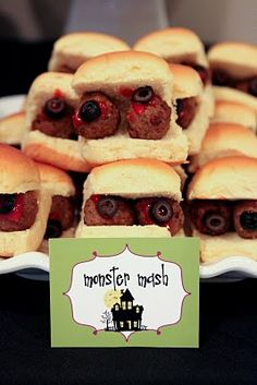 Food for Halloween party. Meat ball marinara sandwich with olive eye, in Hawaiian roll or slider bun.
