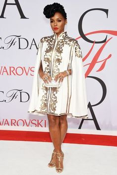 Janelle Monáe attends the 2015 CFDA Awards at Lincoln Center in New York City in a Tadashi Shoji white and gold embroidered cape dress paired with an Edie Parker clutch, jewelry by Lorraine Schwartz and Ofira, and Christian Louboutin sandals. Tadashi Shoji, Look Casual, Casual Chic, Look Fashion, Fashion Beauty, Womens Fashion, Cfda Awards, Cape Dress, Cape Coat