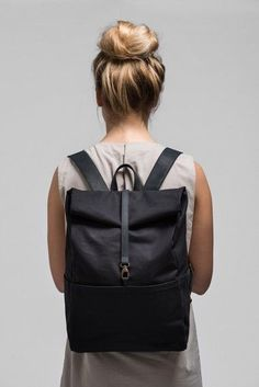 The comfortable yet sophisticated way to carry your belongings. This roll top backpack suits your every need in modern urban life. You might also want to check out the different colour options www.vanook.com Integrated Laptop Case, Roll-Top, Padded Back, Several Inner and Outer Pockets, W 28cm D 12cm, H Closed 38cm H Open 56cm, 900g, Outer Charcoal / Leather Charcoal,