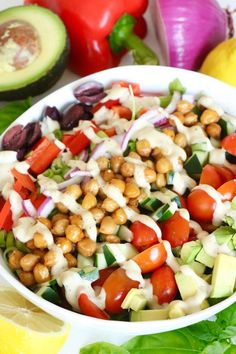 The BIG Vegan Greek Salad has all the classic Greek salad ingredients plus flavorful sautéed chickpeas.  It is topped with a generous drizzle of a lemony, creamy dressing that ties this Mediterranean salad together perfectly.   This hearty salad is 100% vegan, dairy-free, soy-free, nut-free and gluten-free so everyone can enjoy.  Recipe: http://www.eatingbyelaine.com/2016/06/13/vegan-greek-salad/