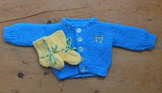 New born knitted gender neutral gift set, Buttery yellow and vivid sky blue cardigan and booties the perfect pressie