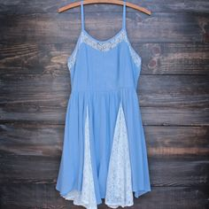 A gauzy lightweight summer dress. Lined but gauzy. Features contrasting lace panels, hidden back zip, and adjustable straps. imported