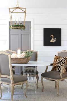 dining room in soothing greys accented with a pop of leopard.