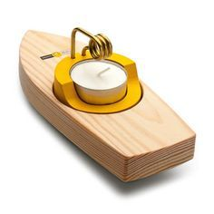 A teeny wooden steamship that actually works! (You light the tea candle.)