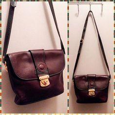 #80s or #90s #burgundy and black #leatherpurse #satchel #shoulderbag with goldtone hardware and adjustable strap.  Medium size. #1980s #1990s #vintageaccessories #purse #niagarafleamarket #rolypolyrecords