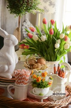 Easter tablescape - love the pansies in a teacup.
