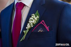 Nautical navy blazer with raspberry tie.