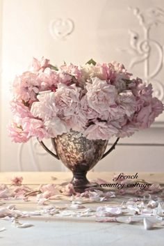 Pink roses look beautiful in a silver tureen.  The fact that it's tarnished just adds to the charm.