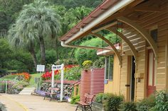 The heritage-listed railway station at Spring Bluff is surrounded by award-winning gardens, which are especially stunning when the flowers are in full bloom Train Journey, South Wales, Day Trips, Brisbane, Beautiful Gardens, Trains, Pergola, Beautiful Places, Language