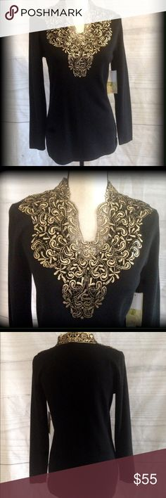 Beautiful gold lace Reba sweater Gorgeous lace neckline on a solid black sweater. So pretty on. I love the way it goes up on each side of neck. Lace goes around all the way on top part as shown in pics. Reba Sweaters