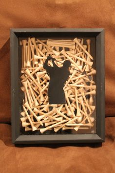 Golf Ball Crafts Black Shadow Box Golf Display, handmade with golf tees for home decor or for the office of any golfer. Golf Home Decor Handmade Home Decor, Cheap Home Decor, Diy Home Decor, Decor Crafts, Craft Gifts, Diy Gifts, Golf Room, Golf Ball Crafts, Golf Art