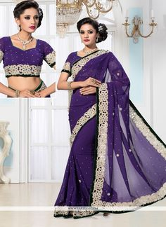 Lovely purple georgette designer saree is create with embroidered, resham, stone and patch border work looks chic and great for any occasion. Comes with matching blouse. (Slight color variation is pos...