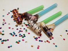 Make Party Blowers from straws and magazines
