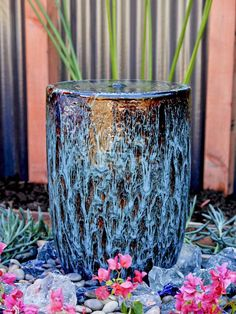 """A decorative water feature provides a strong visual accent as well as a pleasing sound. From HGTV's """"Going Yard"""""""