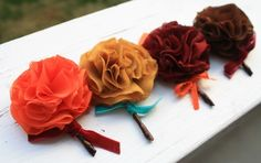 fabric flower boutonnieres 550x347 Inspiration: Non Floral Boutonnieres