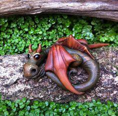 What a sweet dragon! https://www.etsy.com/listing/214114512/ooak-dragon-sculpture