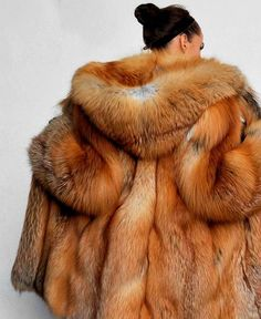 Hooded Red Fox Fur Coat.  I have a red fox that lives behind my house.  She's much more beautiful alive than dead as this coat.  I've named her Rosalie. (Shout out to Grimm fans!)