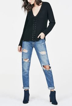 Pullover sweater featuring a deep v-neck, lace-up front detail and notched side seam....