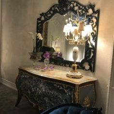 It's golden with ornate embellishments, upholstered in a beautiful silk: It's a baroque sofa. Or is it a Rococo style sofa? Both of these furniture styles Rococo Style, Furniture Styles, Baroque, Entryway Tables, How To Make, Home Decor, Homemade Home Decor, Decoration Home, Interior Decorating