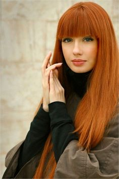 Sleek Orange Carrot Straight Long Cleopatra's Hair Color 2016 Trends with Heavy Bangs