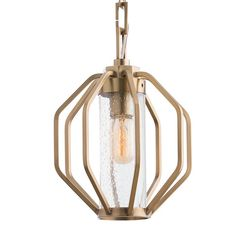 We've adapted our popular Atlas chain-linked sconce for use as a ceiling pendant. Both handsome and jewel like, it centers a textural glass chimney inside an antique brass hexagonal metal cage. Try it as a kitchen pendant, over a library table, or wherever you crave a dash of classic cool. Shown with a radio bulb.   Materials: Iron, Glass Finish: Antique Brass, Seedy Clear Glass