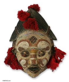 A divine inhabitant of Zairian waters, this mask represents the Kasai River Goddess of the Pende people. Wearing a stylized coiffure, the goddess is accessorized with iron earrings and red cotton tufts.