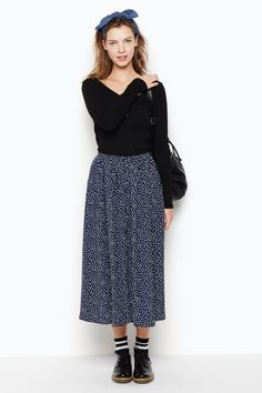 A polka perfect, oh so swishy, mid-length, button-down skirt. The kind of skirt you can dress up or down as you please. Great with sneakers, heels, sweatshirts and tees. Perfect with a cheeky smile.