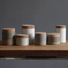 set of 6 pottery corked containers. white porcelain and sand colored stoneware ceramic corked jars. minimal modern handmade ceramics