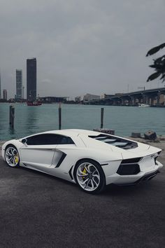 The Lamborghini Huracan was debuted at the 2014 Geneva Motor Show and went into production in the same year. The car Lamborghini's replacement to the Gallardo. The Huracan is available as a coupe and a spyder. Lamborghini Aventador, Carros Lamborghini, Lamborghini Photos, Ferrari 458, White Lamborghini, Maserati, Automobile, Luxury Sports Cars, Sweet Cars