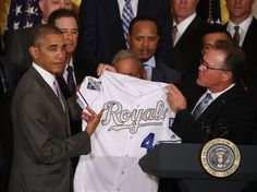 Ned Yost, KC, presents a Royals jersey to Barack Obama as the Royals visit the White House//July 21, 2016