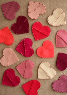 Felt Hearts for stuffing with a note, candy, or the corners of book pages (making it a bookmark.) Can be strung together to make a garland or hung from a spray-painted tree. Versatile!