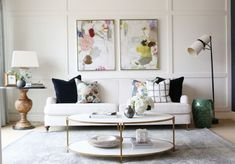 Neutral living room with floral pattern on pillows and artwork