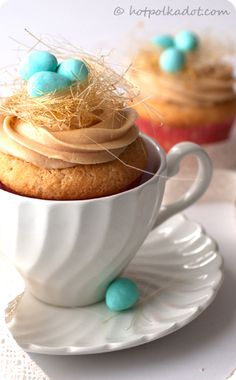 Nests are made of airy threads of spun sugar atop caramel buttercream piped onto vanilla cupcakes.