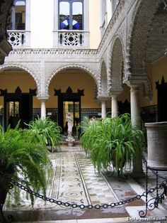 Exploreseville.com: IMG_3373 | 1 - Palacio de Lebrija, Seville Spain. Upon walking in you come to the main patio, a mix of many styles. Here you notice the Mudejar style arches plus the Roman mosaic floor.