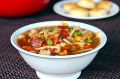 Southwestern Tex-Mex Chicken Noodle Soup  4 cups homemade or low-sodium chicken broth  ½ cup chopped onion  1 tsp. minced garlic  2 cups cooked, cubed chicken  1 15-ounce can (about 1–1 ½ cups) low-sodium corn kernels, rinsed  1 15-ounce can black beans, rinsed  1 15-ounce can diced tomatoes with chilies  4 cups cooked whole wheat noodles or chunky pasta  1 cup fresh cilantro, chopped  4 slices of lime for garnish