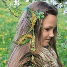 """Feather Hair Clip Peacock Feather Hair Clip Green Feather Hair Clip Tribal Feather Hair Extension Boho Feather Hair Clip """"Flying Fish"""" ♦ Style: • Long feather hair extension • Hippie feather hair band • Tribal feather hair clip • Gypsy feather hair extension • Shamanic feather hair extension • Wild Child feather hair clip • Prom feather hair clip One of a kind and ready to ship! Long peacock feather hair clip in bohemian style. The feathers has funny form of fish tails. Is mounted on your…"""