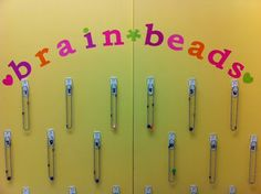 "Brain beads hung on Command(TM) Hooks:  Each kid gets a necklace, add a bead for good ""brain"" work...get to take home at the end of the year!"