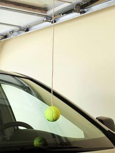 tennis ball hung from ceiling helps tell where you should stop in the garage.