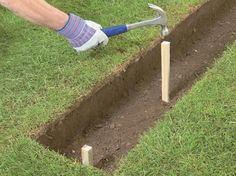 Drive in a stake at each end of the trench down to footing depth, and at intervals of 3 to 6 feet. Make sure they are vertical.