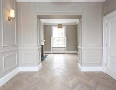 Love the floor and lower half picture moulding. Would paint lower half white and the upper half that grey, but without the moulding. #whitepanelingwallslivingroom