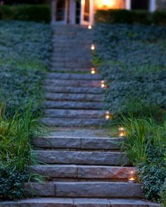 Candles in Mason jars lit the path that led from the dinner tent, through the woods, and down to the stairs. Elegant and effective.