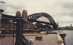 """The Sydney Harbour Bridge, seen here from Circular Quay, is a steel through arch bridge across Sydney Harbour that carries rail, vehicular, bicycle, and pedestrian traffic between the Sydney central business district and the North Shore. The dramatic view of the bridge, the harbour, and the nearby Sydney Opera House is an iconic image of Sydney, and Australia. It was opened in 1932. The bridge is nicknamed """"The Coathanger"""" because of its arch-based design."""